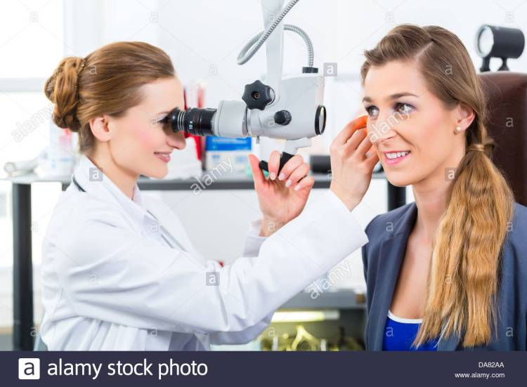 doctor-young-female-doctor-or-ent-specialist-with-a-patient-in-her-DA82AA
